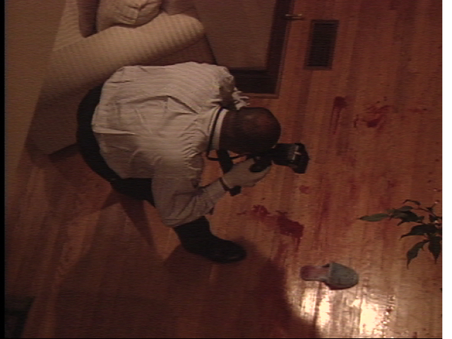 Exhibit A: Secrets of Forensic Science true crime show series Detective taking picture of bloody slipper